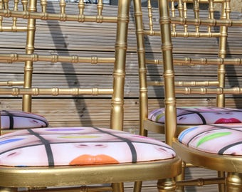 Upcycled gold faux-bamboo chairs with pop art seats (set of four)