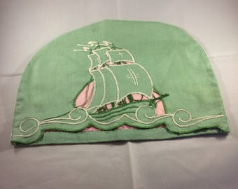 Vintage teacosy. 30s 40s. Green linen with galleon in full sail sutwork and embroidery. Glorious vintage.