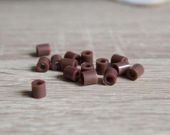 Brown plastic tube beads