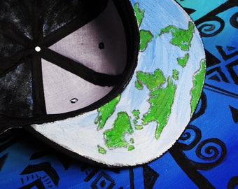 Hand painted hat with the world painted around it!
