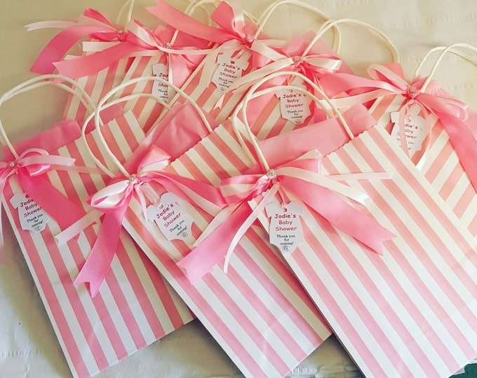 Candy striped baby shower favour bag with personalised gift tag