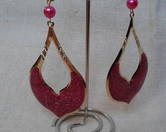 large pink and golden earrings