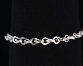 Planished Centerball Foldover Loop-in-Loop Bracelet