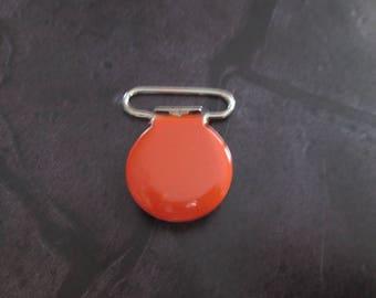 a clip / pacifier round orange enamelled metal