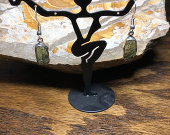 Czech Moldavite wrapped in sterling silver on a sterling silver four prong setting