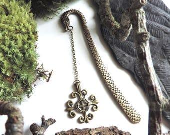 Bronze dragon bookmarks and Occitan cross.
