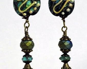 Lamp work black iridescent blue green Czech bead dangle earring
