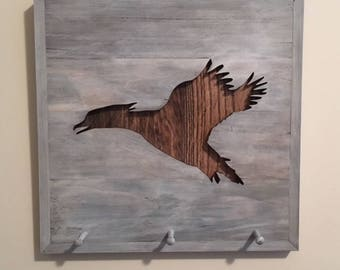 Rustic wood duck silhouette