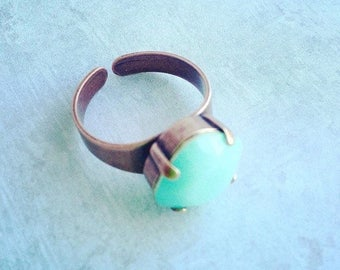 Swarovski statement ring in alabaster mint and copper.