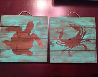 Turtle and Crab Silhouettes, ocean teal in color on wood pallet, 10x10 inches
