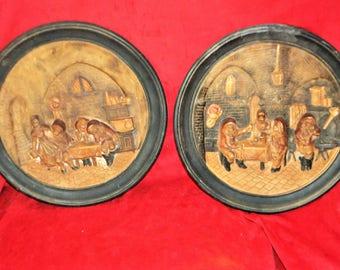Set of 2 decorative wall plates and relief