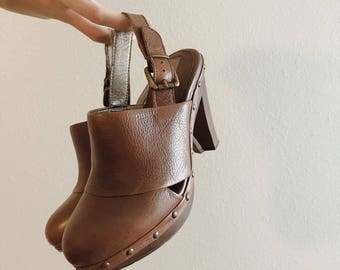 Brown leather clogs