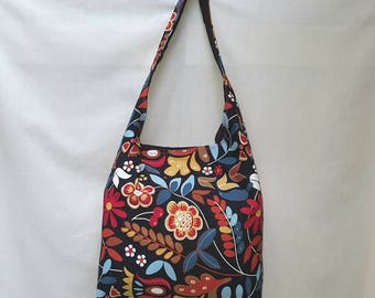 Capacious over-the-shoulder tote in bold floral print.