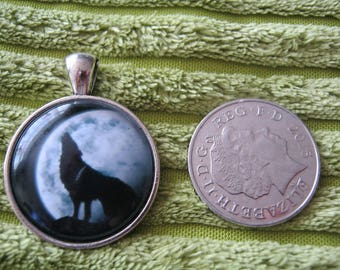 wolf howling at moon pendant