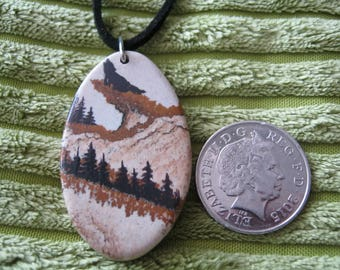 Howling wolf on picture jasper pendant