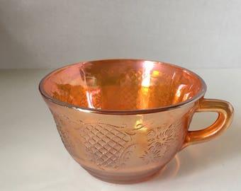 Marigold Carnival Glass Normandie Bouquet lattice teacup.