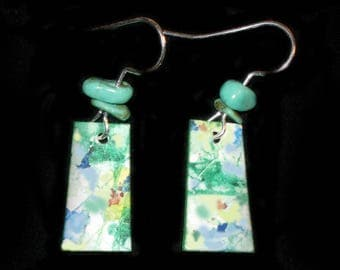 Hand painted earrings with turquoise beads.