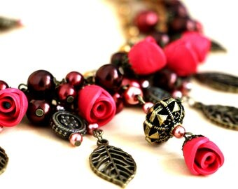 Boho jewelry set earring and necklace with flowers of the polymer clay, leaves and beads