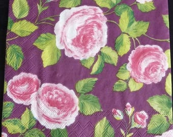Pink roses napkin on purple background