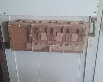 Large wooden lock for hinged door