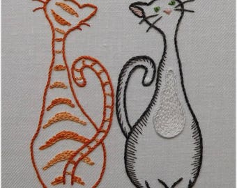 Freestyle embroidery elegant cats with paw prints