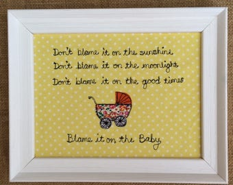 Song lyrics with a twist. Framed picture.