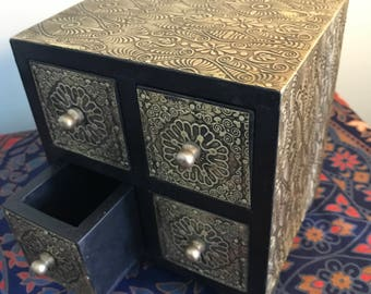 Elegant gold and black four drawer box