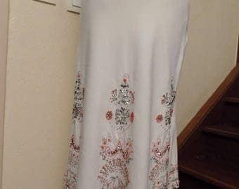 Mid long skirt in white color linen