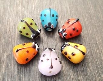 Ladybug lampwork glass beads 15x10mm. Lampwork glass Ladybug beads 15x10mm.