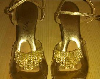 Vintage lucite golden heels.