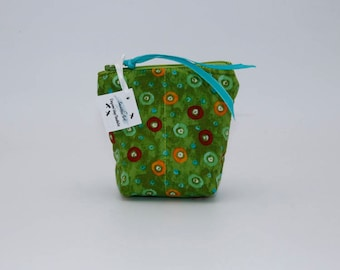 Cosmetic Bag: Small Green with Orange, Rust and Turquoise Circles