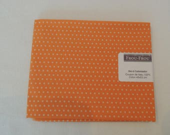 Cotton fabric patch background orange dot
