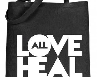 Love heal black tote bag