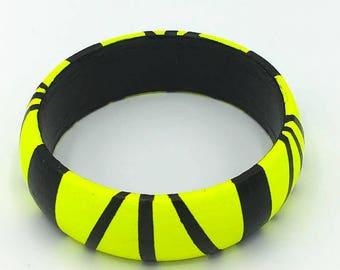 Handmade  bright geometric wooden bangle in neon yellow and black