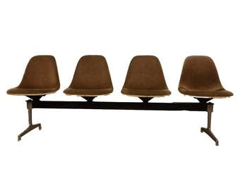 Tandem Bank, Bank of visitors by Charles & Ray Eames for Herman Miller 1964 fiberglass shells