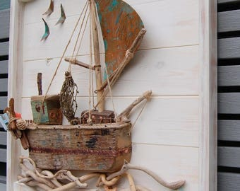Driftwood Fishing Boat with Copper sail. Going Home