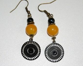 Earrings prints and dangling pearls