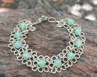 Handcrafted silver toned wire bracelet with aventurine stone beads