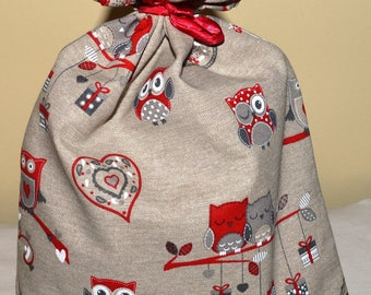 "large pouch lined with links sliding patterns ""owls/heart"""