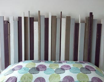 Wooden headboard made with slats in pastel colors