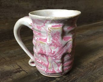 Pink and white ceramic mug