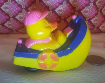 Vintage Easter Unlimited duck friction car boat pull back holiday decoration 1960s driving duck