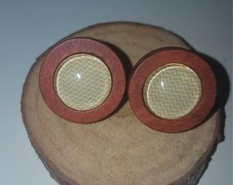 Stud earrings set in cherry wood surrounds