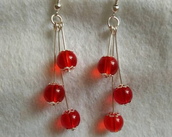 Silver and red glass bead dangle earrings