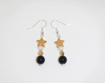 Black and gold star drop Earrings