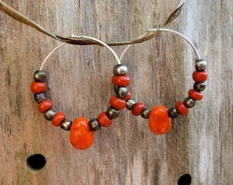 Orange and silver beaded hoops aged