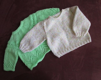 green shirt and speckled white baby sweater