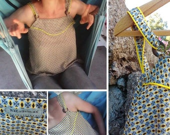 A top with fancy pattern straps and piping