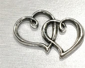 The heart. Two intertwined hearts: A Sterling Silver (lead free) with Tibetan style, 24 x 31 mm