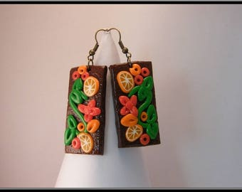Earrings flower and orange polymer clay.
